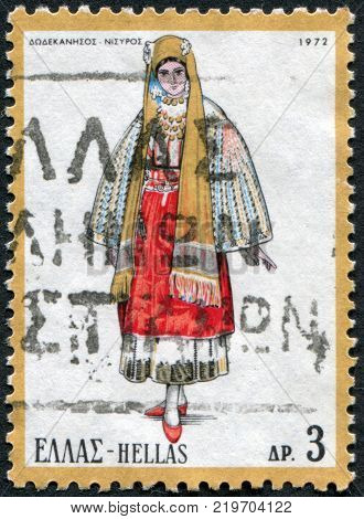 GREECE - CIRCA 1972: A stamp printed in Greece shows the traditional female dress of the island Nisyros circa 1972