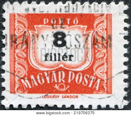 HUNGARY - CIRCA 1958: A stamp printed in Hungary is depicted porto-mark a shield face value 8 filler circa 1958