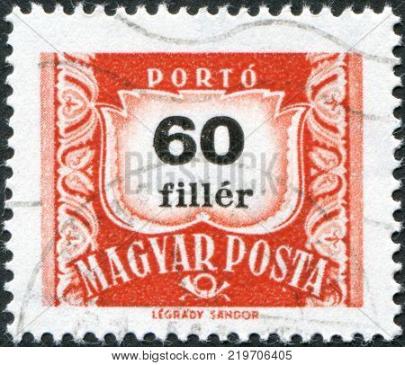 HUNGARY - CIRCA 1958: A stamp printed in Hungary is depicted porto-mark a shield face value 60 filler circa 1958