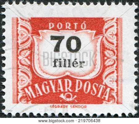 HUNGARY - CIRCA 1958: A stamp printed in Hungary is depicted porto-mark a shield face value 70 filler circa 1958