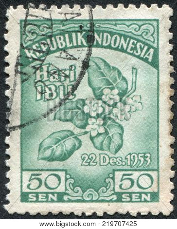 INDONESIA - CIRCA 1953: A stamp printed in the Indonesia is dedicated to Mothers' Day and 25th Anniv of Indonesian Women's Congress. Melati Flowers circa 1953