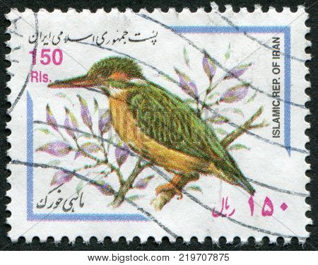 IRAN - CIRCA 1999: A stamp printed in the Iran depicts a bird The Common Kingfisher (Alcedo atthis) circa 1999