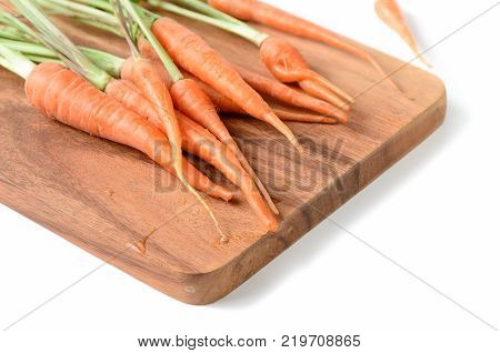 Baby Carrot On Wood Block Isolated On White Background,