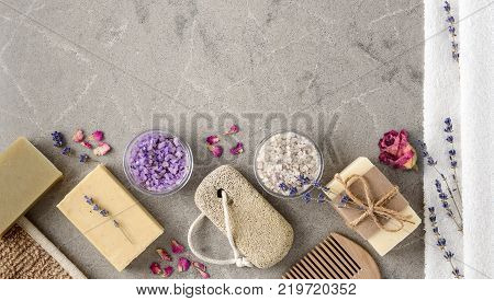 Bath Spa setting with Handmade natural Soaps on marble background top view. Lavender Spa treatment, violet sea salt and dried lavenders. Copy space.