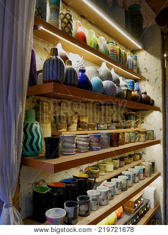 Various Kinds on Collectibles on Shelf with Lights