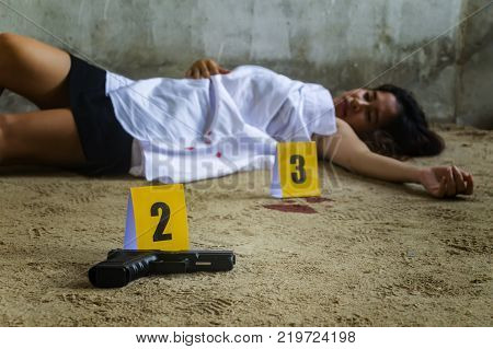 Beautiful young woman was murdered and raped in abandoned house marked with evidence condom.Sexual abuse.