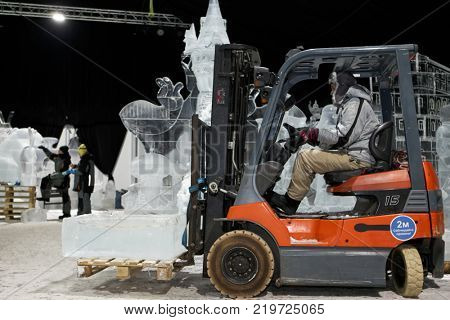 ST. PETERSBURG, RUSSIA - DECEMBER 19, 2017: Transporting of the block of ice  for creating artworks exposed during the festival of ice sculptures Ice Fantasy - 2018. 180 tonnes of ice used this year