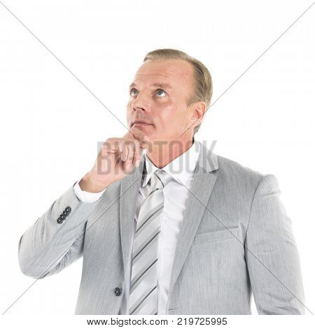 Handsome mature business man think looking up to empty copy space, hold hand on chin isolated over white background