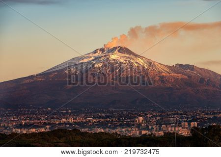 The mount Etna Volcano with smoke and the Catania city Sicily island Italy (Sicilia Italia)