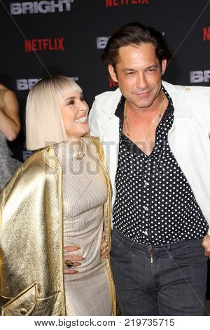 Noomi Rapace and Enrique Murciano attend the Netflix