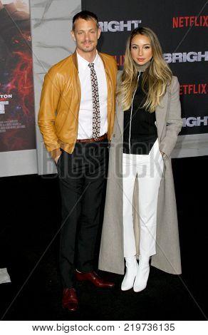 Joel Kinnaman and Cleo Wattenstrom attend the Netflix