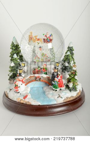 Lugano Switzerland - 21 December 2017: Beautiful snow globe with Christmas decorations on white background