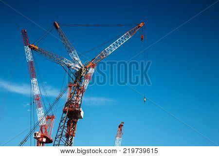 Cranes on blue sky Japan development constraction site