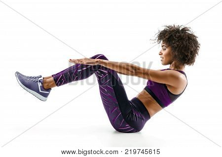Beautiful young girl doing fitness exercise sit-ups abs. Photo of african girl in silhouette on white background. Fitness and healthy lifestyle concept