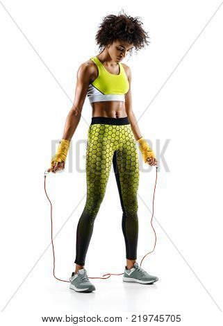 Young girl with skipping rope on white background. Resting time. Best cardio workout