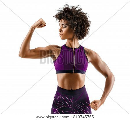 Strong girl with perfect abs shoulders biceps triceps and chest. Photo of sporty young girl on white background. Strength and motivation