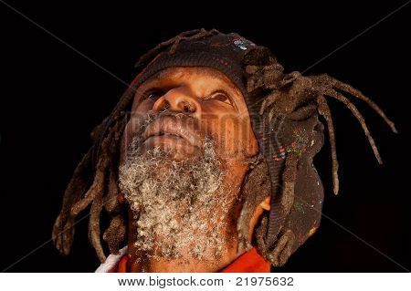 Portrait of african american homeless man with dreadlocks