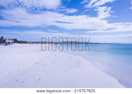 Travel photography - tropical beach with white sand in a caribbean island (Coche island, Margarita, Venezuela).