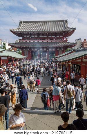 Tokyo - Japan, June 17, 2017; Tourists walking to Edo era Hozomon entrance of Sensoji, also known as Asakusa Kannon Temple, Asakusa