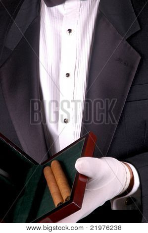 Man in Tuxedo Holding a Wooden Box with Two Cigars