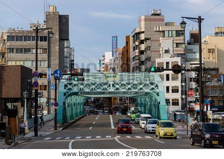 Kanazawa -  Japan - June 9, 2017: Historical iron Saigawa-Ohashi Bridge over the Sai river in Kanazawa