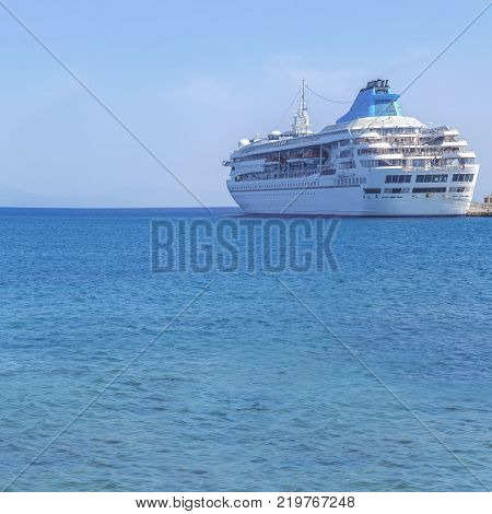Big Modern Luxury Cruise Ship Docked At Marina Dock With Sea Background