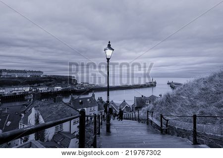 199 steps leading from Whitby Abbey to the harbour entrance and town North Yorkshire England.