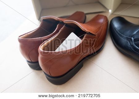 A pair of new men's brown leather shoes