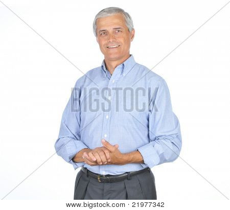 Middle Aged Businessman in Blue Shirt Smiling With Hands Clasped in front of Body isolated on white