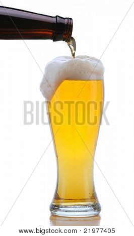 Glass of Beer being Poured from Bottle with Foam Drip and Reflection isolated on white
