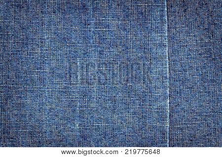 Dark blue jeans texture. Denim jeans texture denim jeans background with a seam. Jeans fashion design.