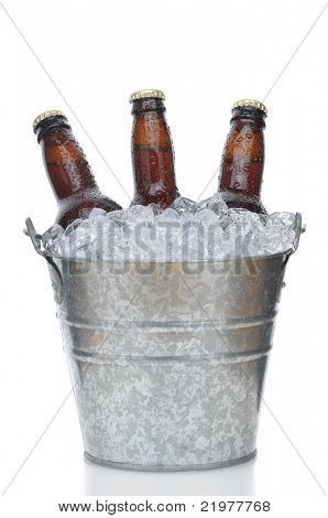 Three Brown Beer Bottles in Ice Bucket with Condensation isolated on white vertical composition with reflection