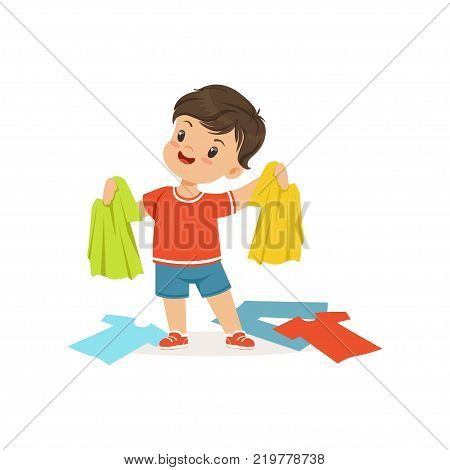 Cute little bully boy standing among scattered clothes, hoodlum cheerful little kid, bad child behavior vector Illustration on a white background