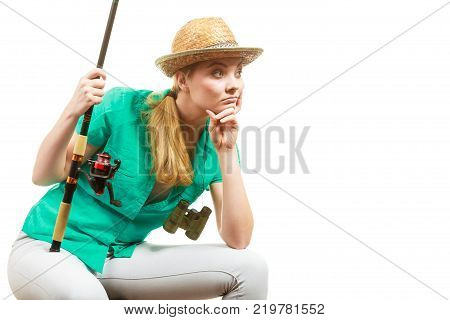 Fishery spinning equipment angling sport and activity concept. Bored woman with fishing rod waiting for fish to hunt.