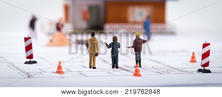 real estate development - construction manager with customers at building site