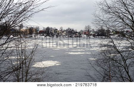 View of Neva River on the outskirts of St. Petersburg at cloud winter day Russia.