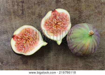 three figs (Ficus carica) on a grunge metal background