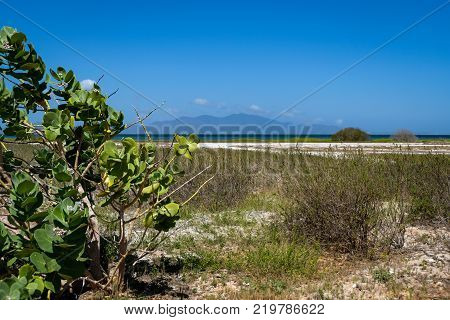 Seascape with a view of Margarita island from a grass field in Coche island (Venezuela).