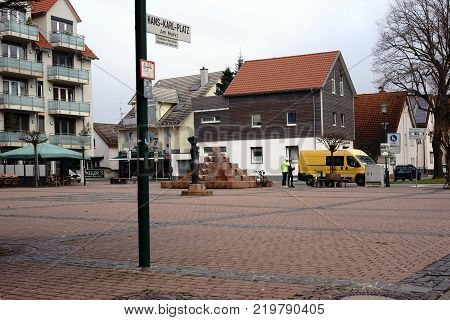 GRIESHEIM, GERMANY - DECEMBER 02: The Hans-Karl-Square, a public square on the market with residential buildings, fountains and sculptures on December 02, 2017 in Griesheim.