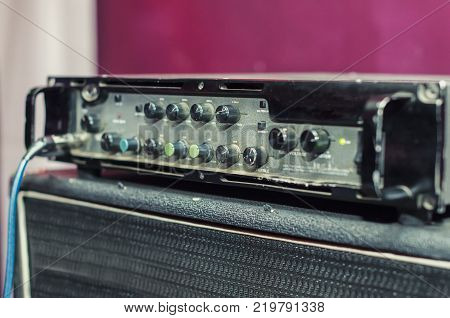 Concert guitar amplifier. Selective focus. electric tube amplifier for guitarist in record studio or live performance concert, rock, jazz, country, folk, pop, heavy metal, classic and more