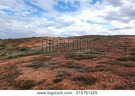 Landscape with a red desertic mountain in Coche island (Venezuela).
