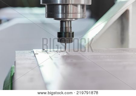 Spindle with cutter. The movement is carried out by the NC program. Close-up.