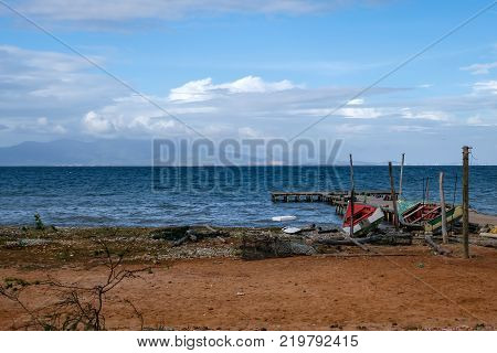 Travel photography - view of Margarita island with fishing boats from Coche island (Venezuela).