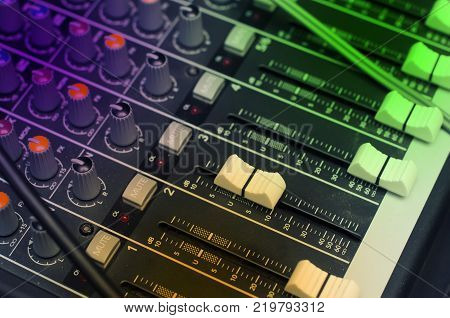 Mixer is used in many applications, including recording studios, public address systems, sound reinforcement, nightclubs, dance clubs, radio, television and film post-production. poster