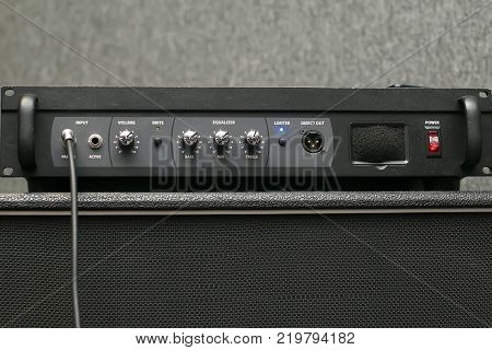 Guitar amplifier, electric tube amplifier for bass guitarist in record studio or live performance concert, rock, jazz, country, folk, pop, heavy metal, classic and more