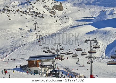 Ischgl, Austria - December 25, 2017: Modern high speed gondolas take hundreds of snow skiers up to the ski field of Ischgl in Austria to make the best of the Winter conditions