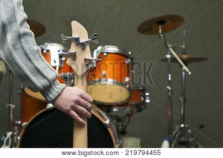Bass guitarist who came to the presentation, hand and guitar neck close up.