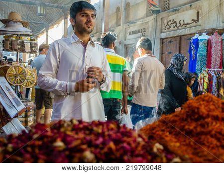 Dubai, UAE, February 5, 2016: Bustling shopping street of Dubai Textile Souk in Bur Dubai