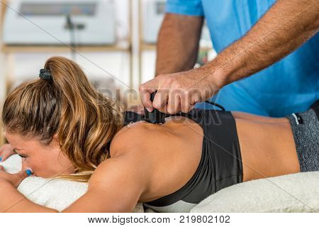 Using ultrasound in physical therapy. Woman patient