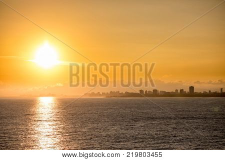 View of the skyline of San Juan, Puerto Rico at sunrise from the sea.
